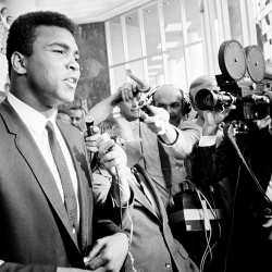 Muhammad Ali talks to reporters after rejecting the US draft