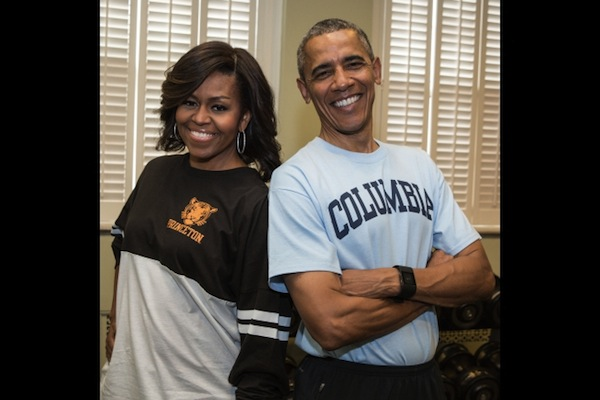 "Michelle and Barack Obama sport their college t-shirts in support of the First Lady's ""Reach Higher"" initiative"