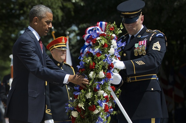 President Barack Obama and with the aid of Sgt. 1st Class John C. Wirth lays a wreath at the Tomb of the Unknowns, on Memorial Day