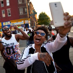 Rappers from Baltimore celebrate after charges are brought in Freddie Grays death