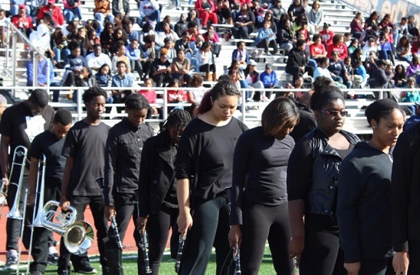 Howard University Showtime Marching Band wears black to protest against the administration for failing to honor band members' music scholarships and general lack of financial support for its students. No stands or 5th period was performed.Photos courtesy of the SHOWTIME Marching Band.
