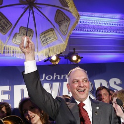 Louisiana Gov.-elect John Bel Edwards holds up an umbrella as he reacts with supporters at his election night watch party in New Orleans, Saturday, Nov. 21, 2015. Edwards won the runoff election for Louisiana governor Saturday, defeating the once-heavy favorite, Republican David Vitter, and handing the Democrats their first statewide victory since 2008. (AP Photo/Gerald Herbert)