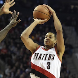 Portland Trail Blazers guard C.J. McCollum (3) points to the bench after hitting a three-point shot during the first half of an NBA basketball game against the Los Angeles Lakers on Saturday, Nov. 28, 2015, in Portland, Ore. (AP Photo/Steve Dykes)