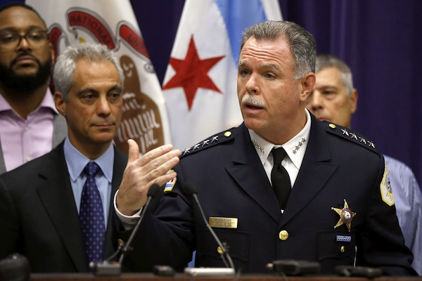 Chicago Mayor Rahm Emanuel, left, and Police Superintendent Garry McCarthy appear at a news conference, Tuesday, Nov. 24, 2015, in Chicago, announcing first-degree murder charges against police officer Jason Van Dyke in the Oct. 20, 2014, death of 17-year-old Laquan McDonald. The city then released the dash-cam video of the shooting to media outlets after the news conference. (AP Photo/Charles Rex Arbogast)