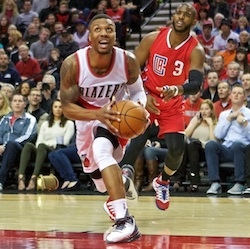 Portland Trail Blazers guard Damian Lillard, front right, drives to the basket past Los Angeles Clippers guard Chris Paul, right, during the first half of an NBA basketball game in Portland, Ore., Friday, Nov. 20, 2015. (AP Photo/Craig Mitchelldyer)