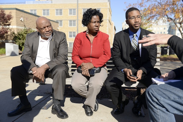 State Reps.Tommie Pierson, left, Karla May, center and Brandon Ellington, right, of the Missouri Legislative Black Caucus talk to Associated Presss reporter Alan Zagier outside the Gaines/Oldham Black Culture Center, Tuesday, Nov. 10, 2015, on the University of Missouri campus in Columbia, Mo. They were there to talk to students and faculty about issues on campus. The meetings were closed to media. (Justin L. Stewart/Missourian via AP)
