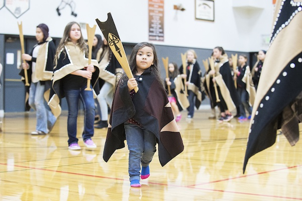 ayde Diaz and other members of the Canoe family, perform a dance during the Grand Ronde tribal flag posting ceremony at the high school gym in Willamina, Ore. (Marcus Larson/News-Register via AP) Nov. 16, 2015