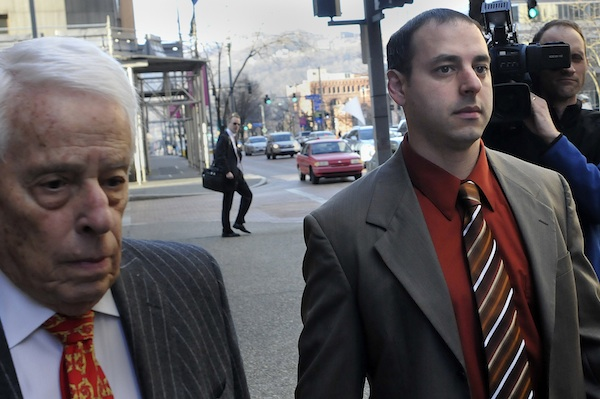 In this March 14, 2012, file photo, former Pittsburgh police officer Adam Skweres, right, arrives with James Ecker, one of his attorneys, for a hearing at the Allegheny County Courthouse in Pittsburgh. Skweres pleaded guilty in 2013 to extorting sexual favors from five women and is serving up to eight years in prison. Allegations against Skweres dated to 2008, yet he remained on the job until a victim complaining to the FBI led to his arrest in 2012. (Larry Roberts/Pittsburgh Post-Gazette via AP, File)