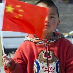 Chinese child waves nation's flag