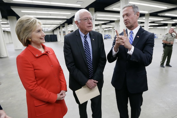 Democratic presidential candidates Hillary Rodham Clinton, left, Sen. Bernie Sanders, I-Vt., center, and former Maryland Gov. Martin O'Malley, talk backstage before the start of the Iowa Democratic Party's Jefferson-Jackson Dinner, Saturday, Oct. 24, 2015, in Des Moines, Iowa. (AP Photo/Charlie Neibergall)