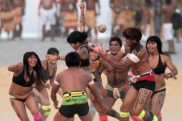 Brazil's Kamayura indigenous people take part in a ball game with hands during the World Indigenous Games in Palmas, Brazil, Thursday, Oct. 29, 2015. Organizers billed the nine-day-long event as a sort of indigenous Olympics. (AP Photo/Eraldo Peres)