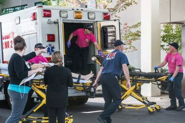 Roseburg Community College campus shooting victims wheeled into ambulance