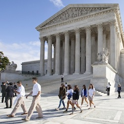 People walk outside the Supreme Court in Washington. The Supreme Court is starting a new term on Oct. 5, 2015, that promises a steady stream of divisive social issues, and also brighter prospects for conservatives who suffered more losses than usual in recent months. (AP Photo/J. Scott Applewhite )