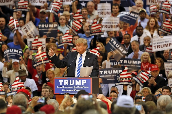 Republican presidential hopeful Donald Trump gestures during a speech to supporters at a rally in Richmond, Va. Oct. 14, 2015. Trump has long boasted about his enormous wealth and how he doesn't need anyone else's money to fund his presidential campaign. But that hasn't stopped tens of thousands of people from across the country from chipping in with small-dollar checks as small as $10 or $25 to let him know that they're behind him. (AP Photo/Steve Helber)