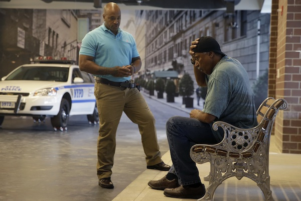 Officer Lamont Edwards talks to actor Nathan Purdee during a Crisis Intervention Training class at the New York Police Department Police Academy, in New York September 2. A new training for New York City police is combining actors, the mentally ill and psychology experts to better prepare officers responding to people in the throes of a mental crisis. (AP Photo/Mary Altaffer)