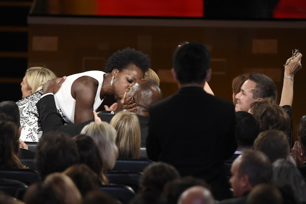 "Viola Davis, left, kisses Julius Tennon before she walks on stage to accept the award for outstanding lead actress in a drama series for ""How to Get Away With Murder"" from Adrien Brody at the 67th Primetime Emmy Awards on Sunday, Sept. 20, 2015, at the Microsoft Theater in Los Angeles. (Photo by Chris Pizzello/Invision/AP)"