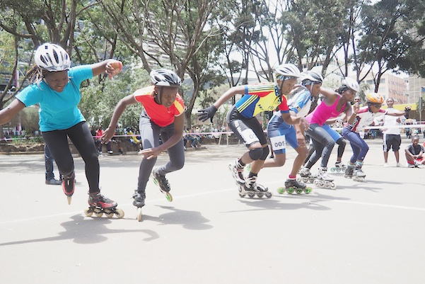 Kenyan women skaters burst into action at the start of a 1000-meter race in downtown Nairobi , Kenya, Sept. 6, 2015. A craze for roller skating has hit Kenya, fueled by its growing middle class and a love for speed. Lameck Wafula is the secretary-general of the Kenyan Federation of Roller Skating, which was created in 1997 with four members and now oversees 60 skating clubs. More than 100 schools feature roller skating at gym. A speed-skating tournament in June drew more than 400 participants from all over Kenya with hundreds more watching. A music video by Kenyan hip hop artist Octopizzo features skating. Even the police department sponsors a skating team. (AP Photo/Jay Lawrence)
