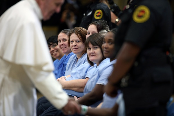 Pope Francis greets female inmates during his visit to the Curran Fromhold Correctional Facility in Philadelphia, Sunday, Sept. 27, 2015. (David Maialetti/The Philadelphia Inquirer, Pool)