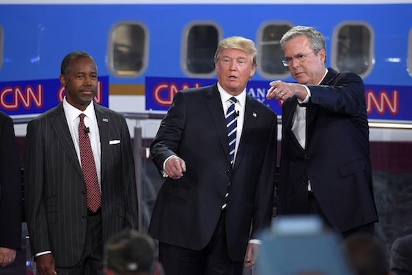 Republican presidential candidates, from left, Ben Carson, Donald Trump, and former Florida Gov. Jeb Bush chat during the CNN Republican presidential debate at the Ronald Reagan Presidential Library and Museum in Simi Valley, Calif. Donald Trump's rivals emerged from the second Republican debate newly confident that the brash billionaire will fade if the primary takes a more substantive turn and that they can play a role in taking him down without hurting their own White House ambitions. Yet in a race that has so far defied standard political logic, that may be little more than wishful thinking. (AP Photo/Mark J. Terrill)