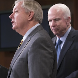 Republican members of the Senate Armed Services Committee, Sen. Lindsey Graham, R-S.C., center, and committee chairman John McCain, R-Ariz., speak at a news conference on Capitol Hill in Washington, Feb. 24, 2016. Graham and McCain are assembling a harsh critique of Donald Trump's worldview by soliciting rebuttals from U.S. military leaders that challenge the accuracy and legality of his most provocative foreign policy positions. (AP Photo/J. Scott Applewhite, File)