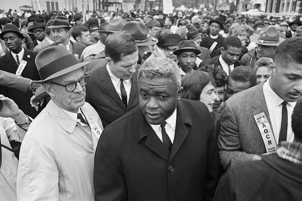 "Former baseball star Jackie Robinson, center, appears with demonstrators in a civil rights march on the capitol in Frankfort, Ky.March 5, 1964. Robinson is the subject of a two-part documentary, ""Jackie Robinson"" directed by Ken Burns, Sarah Burns and David McMahon airing Monday and Tuesday at 9 p.m. on most PBS stations. (AP Photo, File)"