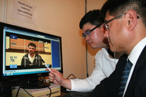 San Francisco State psychologist and company CEO David Matsumoto, right, and colleague looking at the non-verbal behavior of another employee on video as part of their analysis for deception and emotional clues, in Berkeley, Calif. in 2013. Scientists say we all lie, and this year, politicians are bending the truth big time, with real consequences. By studying how and why we deceive, the experts say they can help us better understand the 2016 election season. (Hyisung C. Hwang/Humintell via AP)