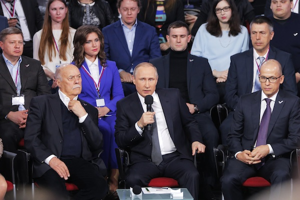 Russian President Vladimir Putin, center, speaks during a media forum of the All-Russia People's Front in St.Petersburg, Russia, Thursday, April 7, 2016. Speaking Thursday at a media forum in St.Petersburg, Putin rejected links to offshore accounts, calling the leaks part of Western efforts to weaken Russia. (AP Photo/Dmitri Lovetsky, Pool)