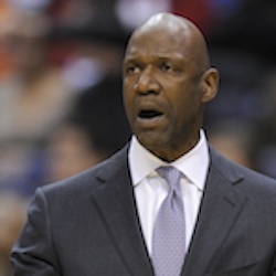 In this Jan. 25, 2013, file photo, Minnesota Timberwolves acting coach Terry Porter gestures during the team's NBA basketball game against the Washington Wizards in Washington. The University of Portland has hired Porter as its basketball coach. Porter will be introduced as the team's coach at a campus event on Tuesday, the school announced Friday night, April 1, 2016. He will replace Eric Reveno, who was dismissed last month after 10 years with the Pilots. (AP Photo/Nick Wass, File)