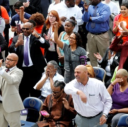 The crowd reacts during Gov. Terry McAuliffe's announcement on the restoration of rights to felons in Virginia at the Capitol in Richmond, Va.