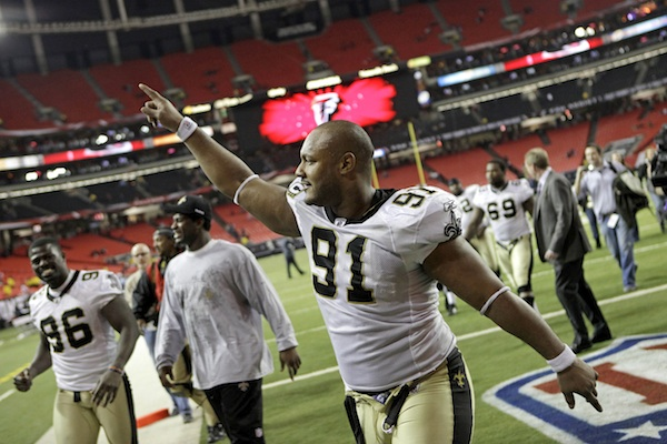 Dec. 27, 2010, file photo, New Orleans Saints defensive end Will Smith (91) celebrates a 17-14 win over the Atlanta Falcons in an NFL football game in Atlanta. Smith was fatally shot after a traffic accident in New Orleans. (AP Photo/David Goldman, File)