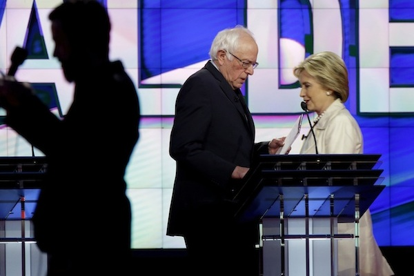 Democratic presidential candidates Sen. Bernie Sanders, I-Vt., left, and Hillary Clinton pass during a break at the CNN Democratic Presidential Primary Debate at the Brooklyn Navy Yard on Thursday, April 14, 2016 in New York. (AP Photo/Seth Wenig)