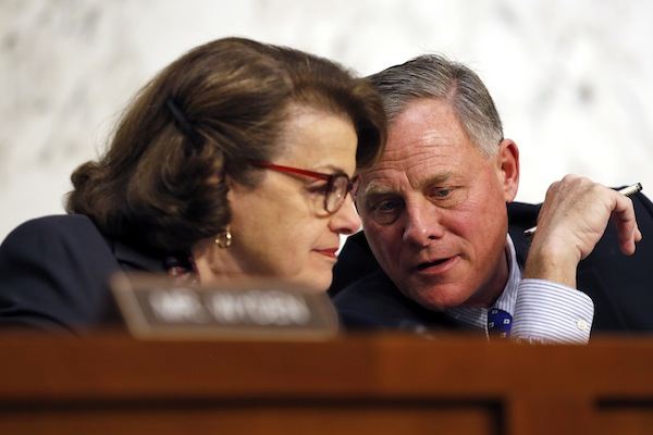 Senate Intelligence Committee Vice Chair Sen. Dianne Feinstein, D-Calif., talks with committee chairman Sen. Richard Burr, R-N.C. on Capitol Hill in Washington, Feb. 9, 2016. A draft version of a Senate bill would effectively prohibit unbreakable encryption and require companies to help the government get access to readable data on a device if there's a lawful search warrant. The draft is being finalized by Burr and Feinstein. (AP Photo/Alex Brandon, File)