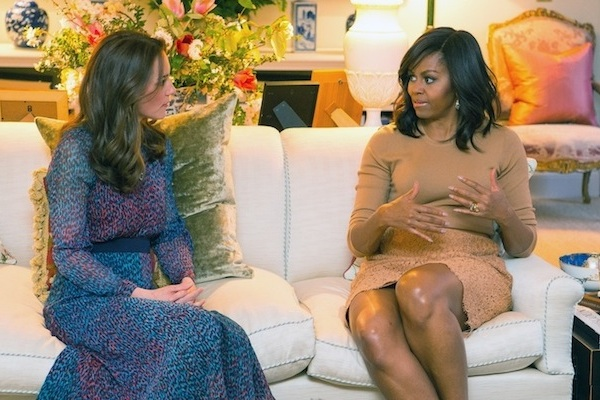 Britain's Kate Duchess of Cambridge talks with US first lady Michelle Obama, right, in the Drawing Room of Kensington Palace, London, prior to a private dinner hosted by Prince William and Kate, Friday April 22, 2016. US President Barack Obama and Michelle plunged into a whirlwind visit to England with royal socializing and political talks. (Dominic Lipinski/Pool via AP)