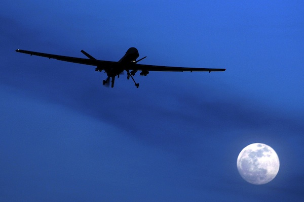 An unmanned U.S. Predator drone flies over Kandahar Air Field, southern Afghanistan, on a moon-lit night, Jan. 31, 2010. The White House has a released a version of President Barack Obama's three-year-old directive on the use of lethal force against terrorists overseas, laying out what it says are safeguards to minimize civilian deaths and errant strikes while preserving the capability to take quick action with drone attacks and other means.(AP Photo/Kirsty Wigglesworth, File)