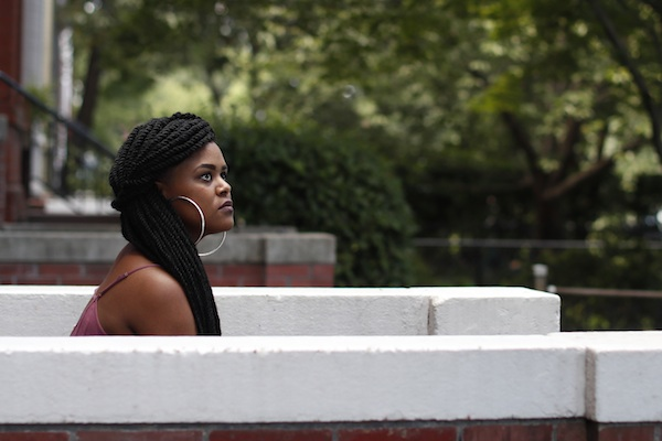 Courtney Grayton, 22, sits outside her parents home in Washington on Sunday, Aug. 7, 2016. Under the Affordable Care Act, she was able to get health insurance coverage from her mother's plan after graduating with an economics degree from the University of Maryland-Baltimore County in 2015 and landing only a part-time job. (AP Photo/Carolyn Kaster)