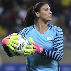 U.S. goalkeeper Hope Solo takes the ball during a women's Olympic football tournament match against New Zealand in Belo Horizonte, Brazil. Solo has been suspended form the team for six months for what U.S. Soccer termed conduct