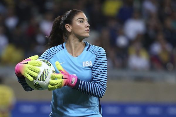 "U.S. goalkeeper Hope Solo takes the ball during a women's Olympic football tournament match against New Zealand in Belo Horizonte, Brazil. Solo has been suspended form the team for six months for what U.S. Soccer termed conduct ""counter to the organization's principles."" The suspension is effective immediately. U.S. Soccer President Sunil Gulati said Wednesday, Aug. 24, that comments Solo made after the U.S. lost to Sweden during the Rio Olympics were ""unacceptable and do not meet the standard of conduct we require from our National Team players."" (AP Photo/Eugenio Savio, File)"