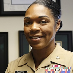 Maj. Shanelle Porter, commanding officer at the Recruiting Station Chicago poses in her office in Des Plaines, Ill. Aug. 5, 2016. The U.S. Marine Corps is looking for a few more good women. And this time the campaign's a bit different. Marine recruiters are turning to girls high school sports teams to find candidates who may be able to meet the Corps' rigorous physical standards _ including for front-line combat jobs now open to women. (AP Photo/Tae-Gyun Kim)