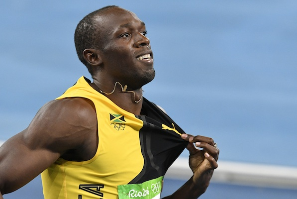 Jamaica's Usain Bolt celebrates winning the gold medal in the men's 4x100-meter relay final during the athletics competitions of the 2016 Summer Olympics at the Olympic stadium in Rio de Janeiro, Brazil, Friday, Aug. 19, 2016. (AP Photo/Martin Meissner)
