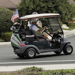 Duncan Wallace drives a golf cart from his house to his golf club as a group of landscape workers take a break in Vista, Calif. Income inequality has surged near levels last seen before the Great Depression. The average income for the top 1 percent of households climbed 7.7 percent last year to $1.36 million, according to tax data. That privileged sliver of the population saw pay climb at almost twice the rate of income growth for the other 99 percent, whose pay averaged a humble $48,768. (AP Photo/Gregory Bull, File)