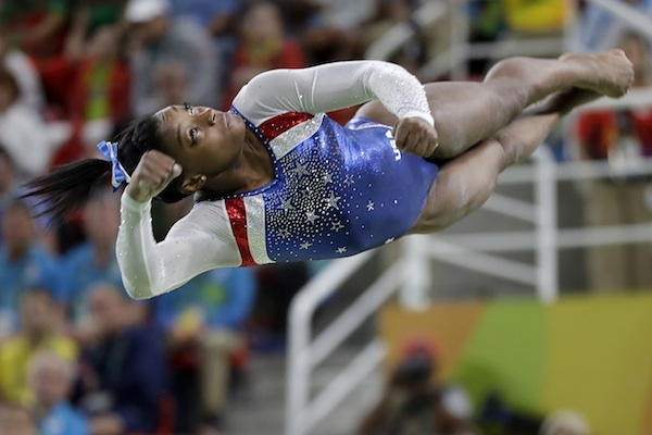 United States' Simone Biles performs on the vault during the artistic gymnastics women's individual all-around final at the 2016 Summer Olympics in Rio de Janeiro, Brazil, Thursday, Aug. 11, 2016. (AP Photo/David Goldman)