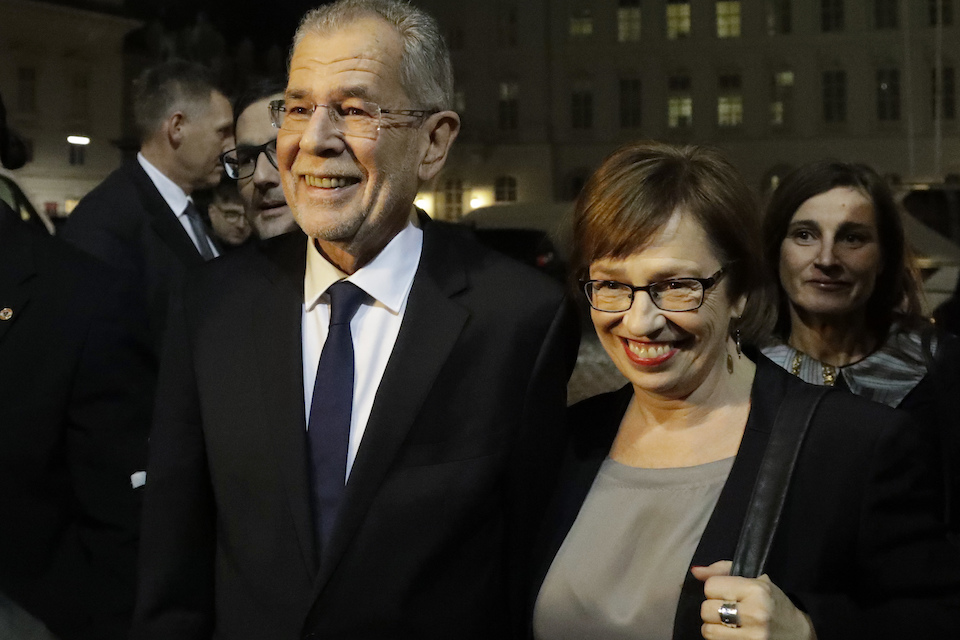 Alexander Van der Bellen, candidate of the Austrian Greens, and his wife Doris Schmidauer leave a polling station after casting their votes in Vienna, Austria, Sunday, Dec. 4, 2016. Austria holds presidential elections in a contest pitting a left-leaning contender against a right-winger supported by a populist anti-immigration party. (AP Photo/Matthias Schrader)