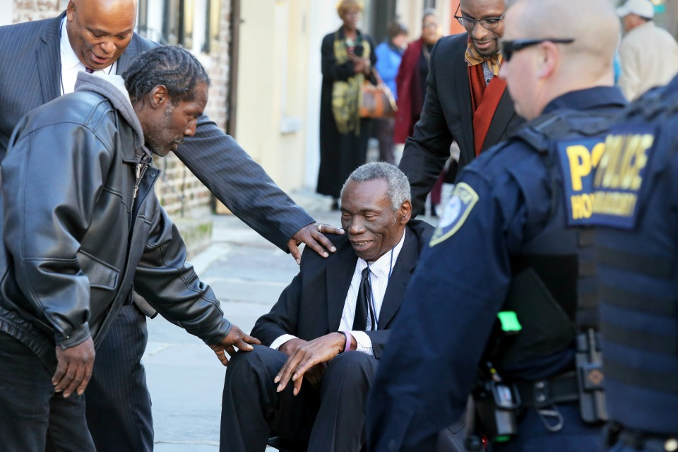 John Pinckney, father of shooting victim Rev. Clementa Pinckney, is greeted after leaving J. Waites Waring Federal Courthouse in Charleston, S.C.