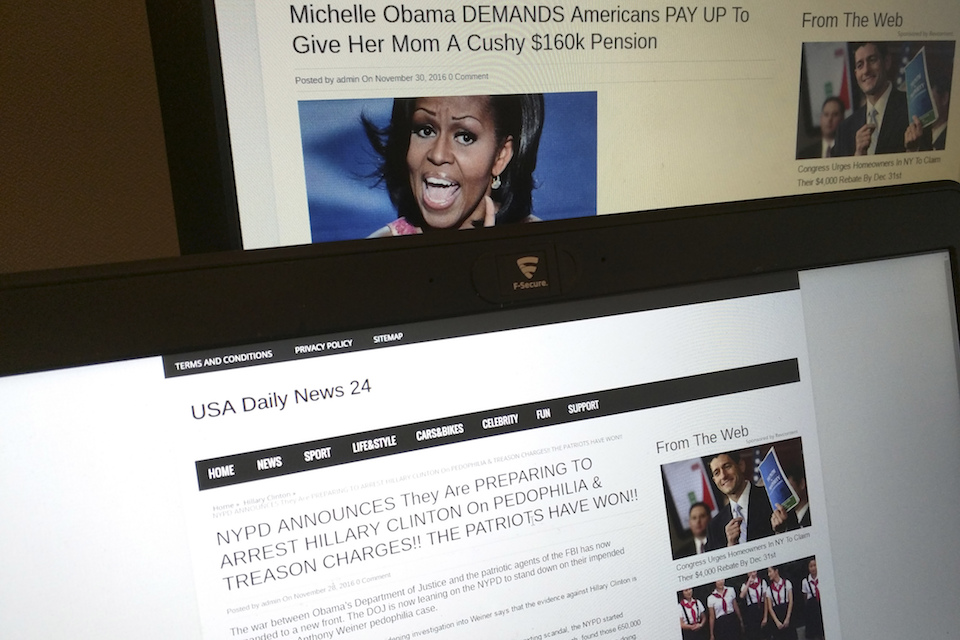This photograph taken in Paris Friday Dec. 2, 2016 shows stories from USA Daily News 24, a fake news site registered in Veles, Macedonia. An Associated Press analysis using web intelligence service Domain Tools shows that USA Daily News 24 is one of roughly 200 U.S.-oriented sites registered in Veles, which has emerged as the unlikely hub for the distribution of disinformation on Facebook. Both stories shown here are bogus. (AP Photo/Raphael Satter)