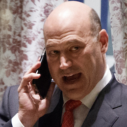 Goldman Sachs COO Gary Cohn talks on his phone as he waits for the start of a meeting with President-elect Donald Trump at Trump Tower in New York, Nov. 29, 2016. Trump is expected to pick Cohn to lead the White House National Economic Council, according to two people informed of the decision. (AP Photo/Evan Vucci)