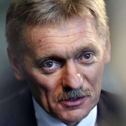 Kremlin press secretary Dmitry Peskov talks to a reporter in New York, Thursday, Nov. 10, 2016. In careful phrasing befitting the spy he once was, Peskov, top Russian diplomat and Vladimir Putin's spokesman, said Thursday that Russian experts were in contact with some members of President-elect Donald Trump's staff during the presidential campaign, a period in which the United States accused Russia of hacking into Democratic Party emails systems. A spokeswoman for Trump denied the assertion. (AP Photo/Seth Wenig)