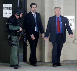 Michael Slager, center, walks from the Charleston County Courthouse under the protection from the Charleston County Sheriff's Department
