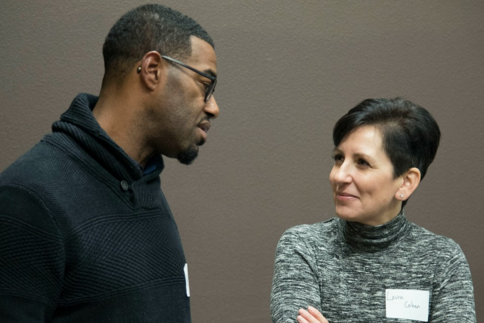 Kory Murphy of the Department of County Assets talks with Laura Cohen, project manager of LEAD at program outreach dinner. (Multnomah County)
