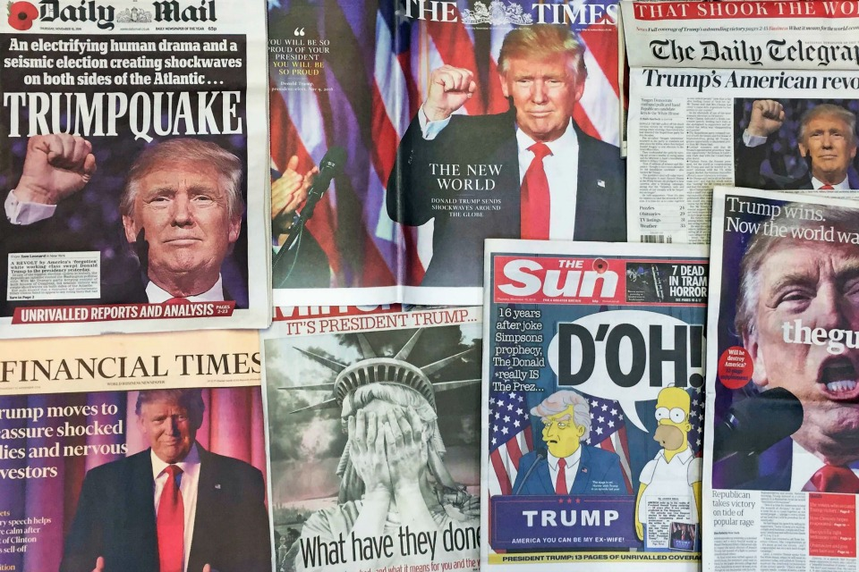 the front pages of various British newspapers in London reporting on Donald Trump winning the U.S. presidential election