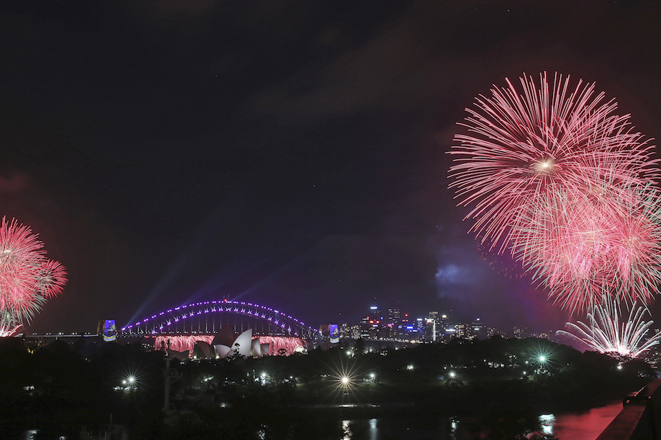 Fireworks explode around the Sydney Opera House and Harbour Bridge as New Year's celebrations get underway in Sydney, Australia, Saturday, Dec. 31, 2016. (AP Photo/Rick Rycroft)